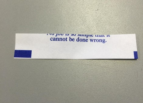 """fortune cookie fortune that says """"no job is so simple that it cannot be done wrong"""", but the paper has been cut incorrectly and half the text is missing"""
