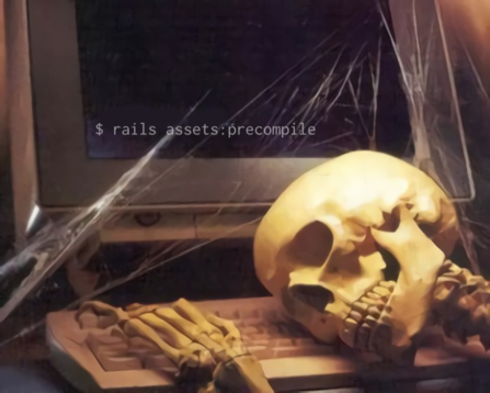 """skeleton lying on a keyboard in front of a computer screen reading """"$ rails assets:precompile"""""""