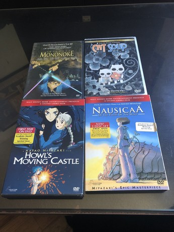 DVDs for Princess Mononoke, Cat Soup, Howl's Moving Castle, and Nausicaä oh the Valley of the Wind