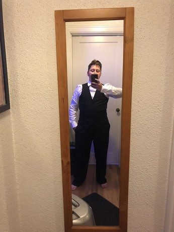 me in dress shirt, trousers, and vest