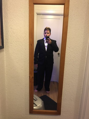 me in dress shirt, trousers, and suit jacket