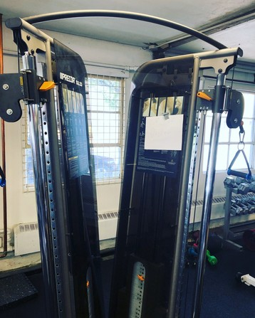 """some fitness equipment at my gym, horribly askew and leaning over, with a small paper """"out of order"""" sign taped to it"""